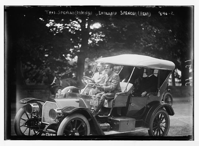 Thos. Spencer, driving, and Lorillard Spencer in rear of auto, Newport