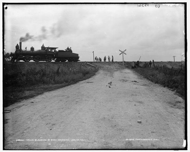 Track elevating at road crossing, Joliet, Ill.
