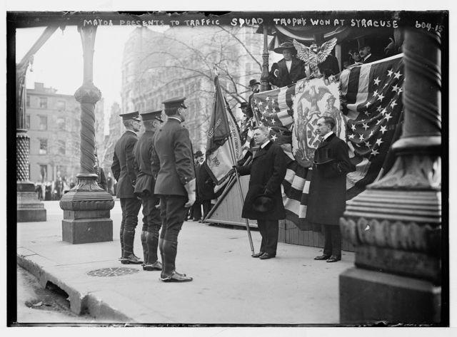 Traffic Squad Parade, Mayor McClellan presents to Traffic Squad trophy won at Syracuse, New York