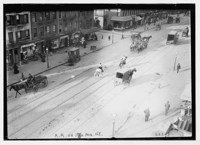 Train tracks and horse-drawn carts on 11th Ave. , New York City