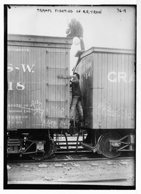 Tramps fighting between railroad cars