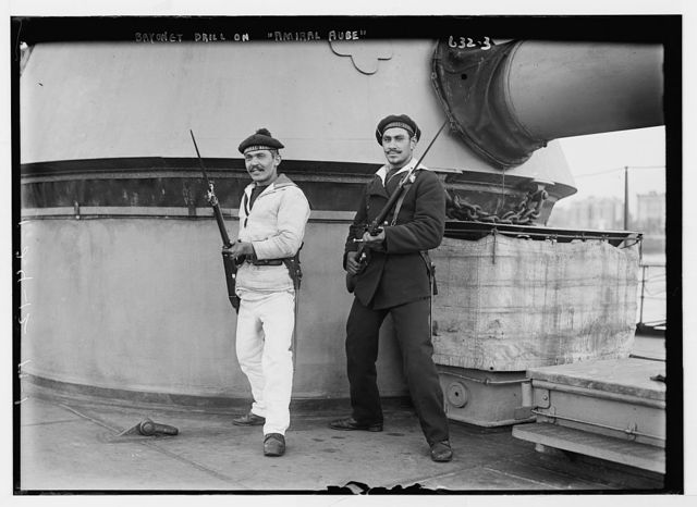 Two sailors in bayonet drill aboard deck of Amiral Aube, French ship
