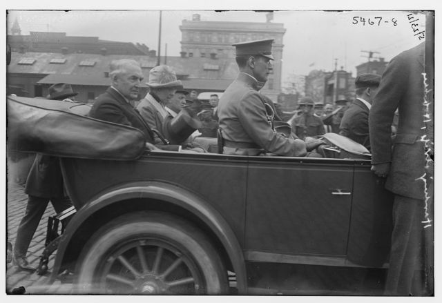 [Unidentified man and woman riding in back of car]