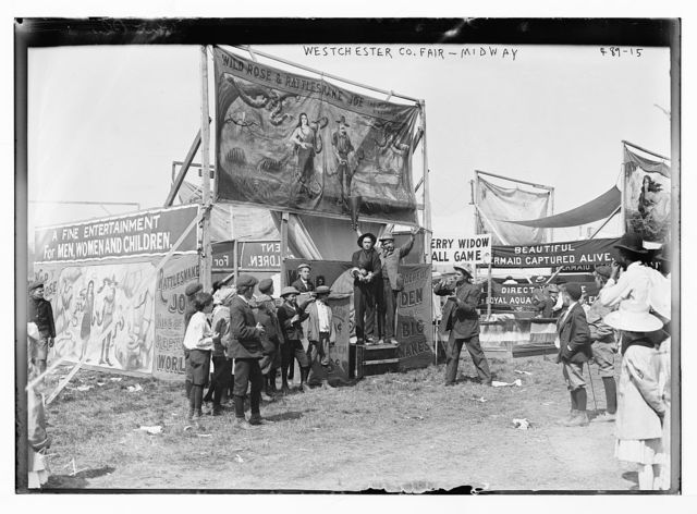 Westchester Co. Fair - Midway [booth of Wild Rose and Rattlesnake Joe, New York]