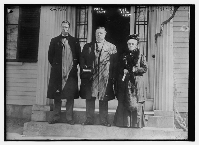 W.H. Taft, Pres. Taft and Miss Delia Torrey standing together on steps