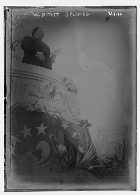 W.H. Taft, speaking from dais