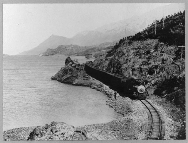 White Pass Railway train on the shores of Lake Bennett