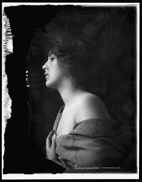 [Woman model in profile with hand at bosom, half-length portrait]