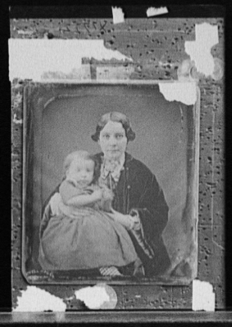 [Woman with baby girl, possibly mother and daughter]