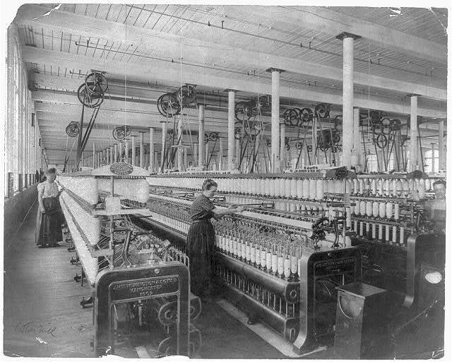 [Women and machinery in New England cotton mill, ca. 1900]