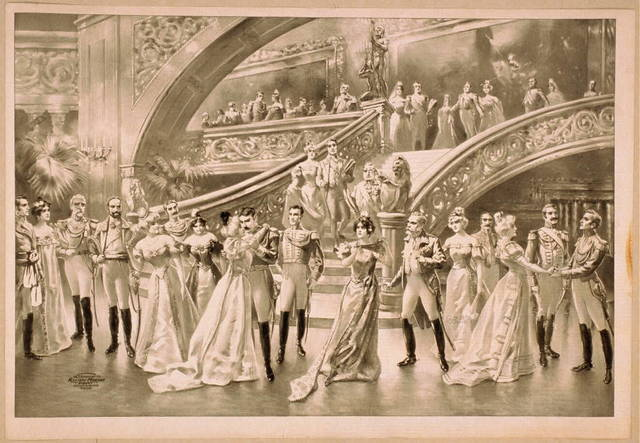 [Women in ball gowns and men in military uniforms observing embracing couple at foot of staircase]
