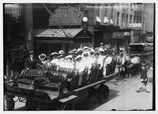 Women in large carriage on street for Cleveland New Party