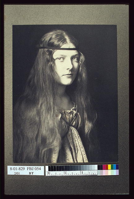 [Young woman in period dress with headband] / Emily Mew.
