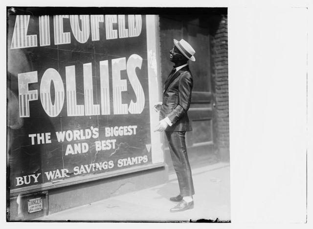"Ziegfield Follies bill-board with ad. ""Buy War Savings Stamps"""