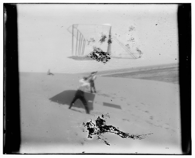 [1901 glider soaring, photograph from an out of focus, water-damaged negative]