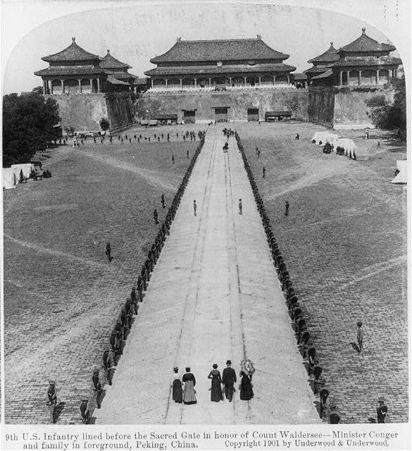 9th U.S. Infantry lined before the sacred gate in honor of Count Waldersee - Minister Conger and family in foreground, Peking, China