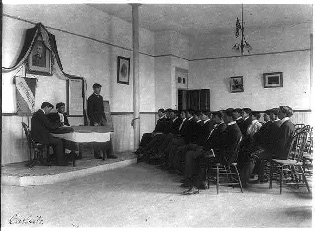 [Carlisle Indian School, Carlisle, Pa. Classroom debate by debating society]