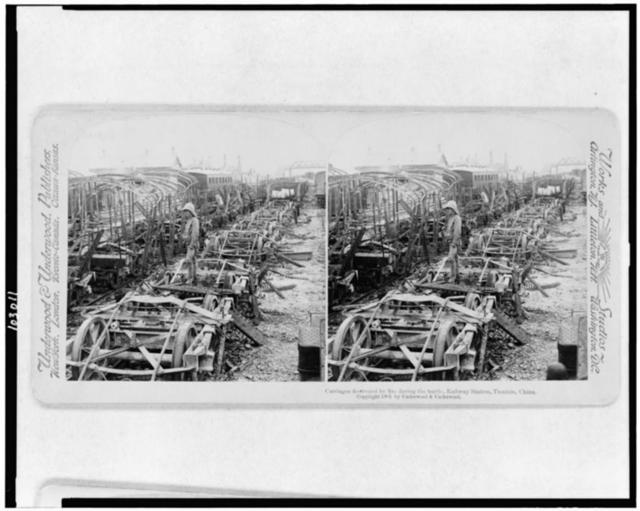 Carriages destroyed by fire during the battle, railway station, Tientsin, China