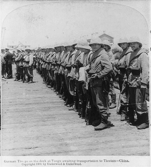 German troops on the dock at Tongu awaiting transportation to Tientsin, China.