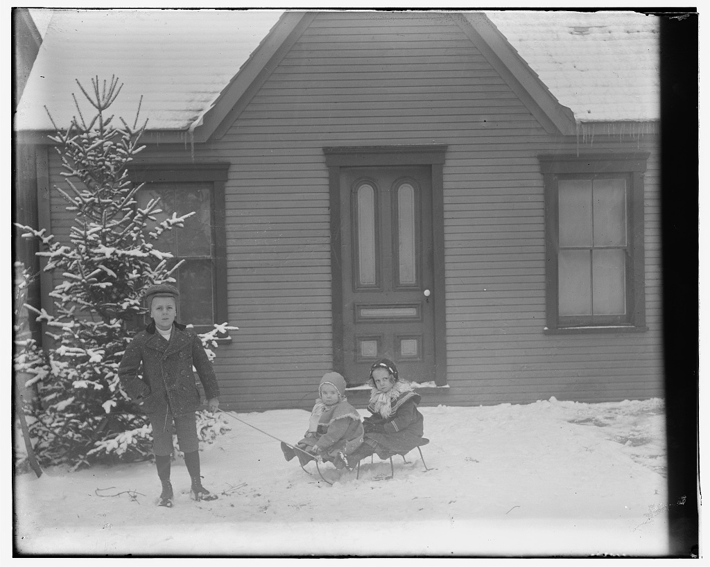 [Milton Wright, Ivonette Wright, and Leontine Wright seated on sled]