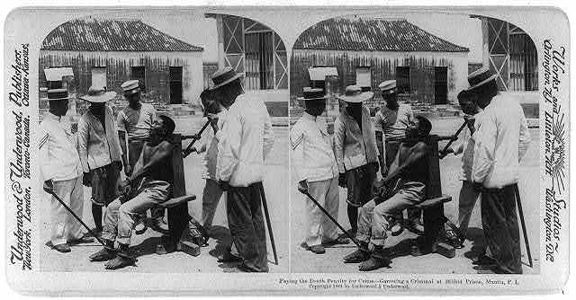 Paying the death penalty for crime - garroting a criminal at Bilibid Prison, Manila, P.I.