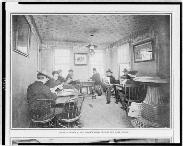 """The Army canteen as it really is--The reading-room at the Bedloe's Island canteen, New York Harbor / photographed for """"Leslie's Weekly"""" by its staff photographer, R.L. Dunn."""