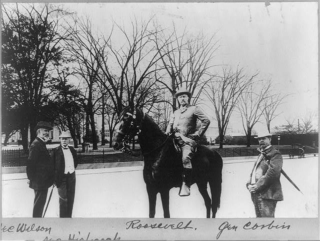 [Theodore Roosevelt on horseback with Secretary of Agriculture Wilson, Secretary of Interior Hitchcock, and General Corbin]