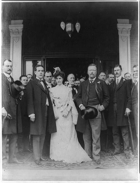 [Theodore Roosevelt with cabinet members, other men, and a woman, possibly a bride]