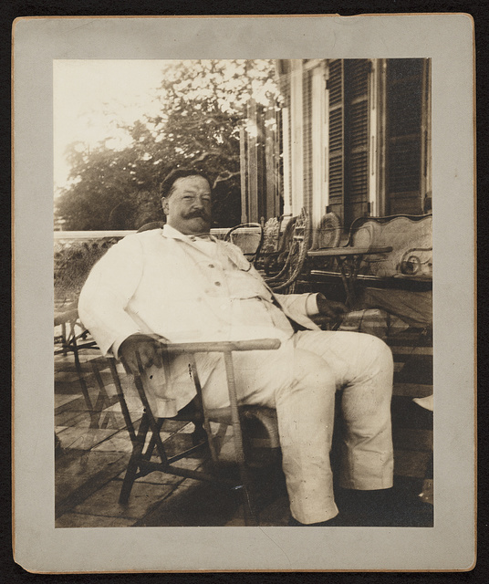 [William H. Taft, seated in a wicker chair, probably during his tenure as Governor-General of the Philippines]