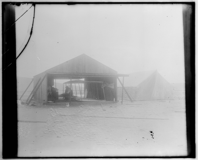 [Wright brothers rebuilding their glider in a wooden shed erected in July to serve as a workshop and to house the glider in bad weather, August, 1901; Kitty Hawk, North Carolina]