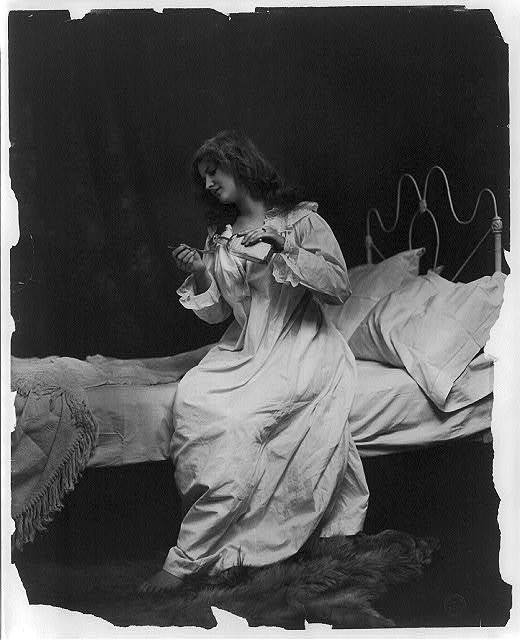 [Young women modeling: pouring spoon of medicine]