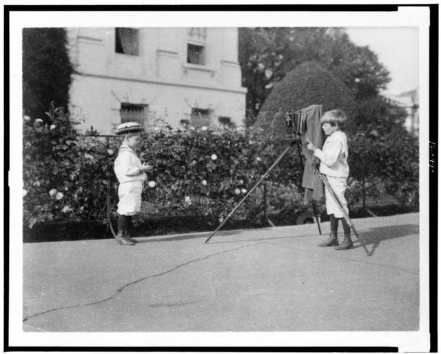 [Archie Roosevelt photographing Quentin Roosevelt outdoors]