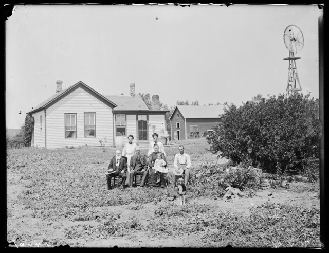 Family in front of a farmhouse in Buffalo County, Nebraska