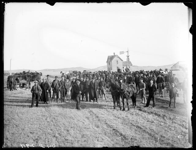 Large group attending outdoor sale at the Blakenship place, west of Broken Bow, Nebraska.