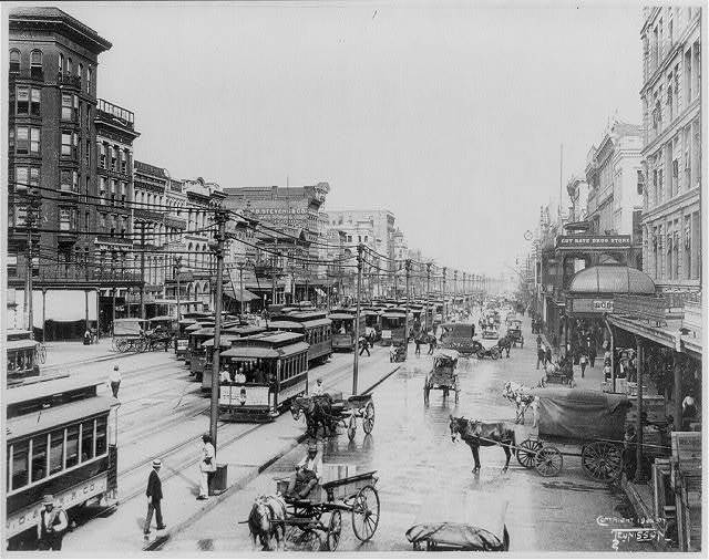 [Louisiana - New Orleans - crowded street scene looking down Canal St.]