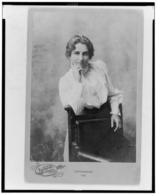 [Maud Ballington Booth, half-length portrait, standing behind chair, facing front]
