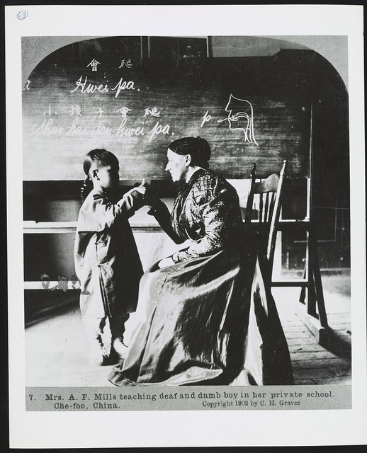 Mrs. A.F. [i.e. A.T.] Mills teaching deaf and dumb boy in her private school, Che-foo, China