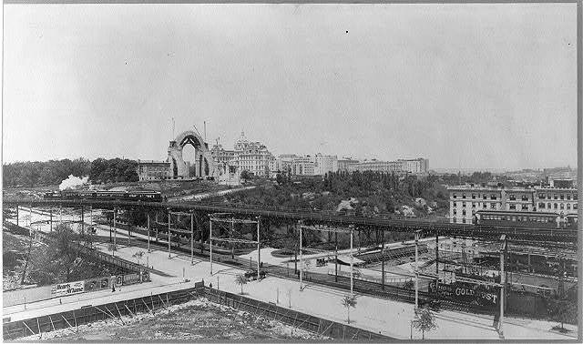 New York City: Morningside Park and Cathedral Heights, showing construction of Cathedral of St. John the Divine; elevated train in fg.