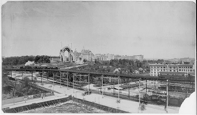 [New York City: Morningside Park & Cathedral Heights - showing elevated railroad. Cathedral constr. in background]