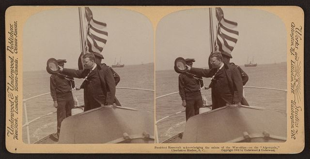 """President Roosevelt acknowledging the salute of the war-ships - on the """"Algonquin,"""" Charleston Harbor, S.C."""