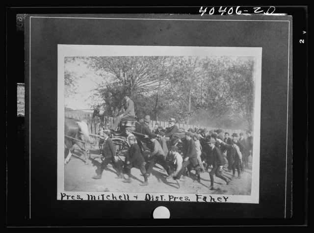 Shenandoah, Pennsylvania. John Mitchell, President of the UMWA (United Mine Workers of America), arriving in the coal town. His open four-horse carriage is surrounded by a crowd of boys. The driver of the high front seat is wearing a derby hat