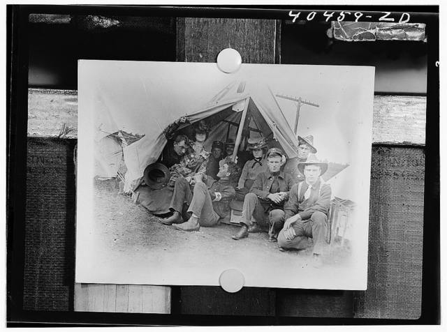 Shenandoah, Pennsylvania. Several American Red Cross workers and some friends posing for a picture at a tent on the encampment grounds where the militia had been called during the coal mining strike