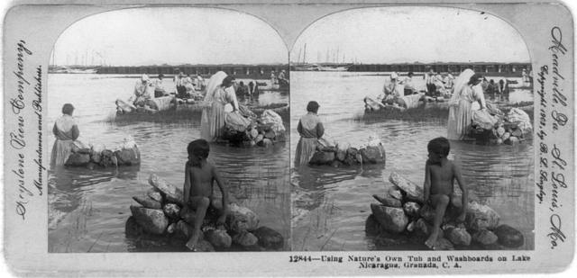 Using nature's own tub and washboards on Lake Nicaragua, Granada, C. A.