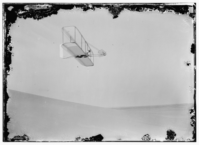 [Wilbur gliding to the right, bottom view of glider]