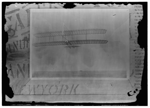 [Wilbur Wright gliding from No. 2 Hill, west of the camp building]