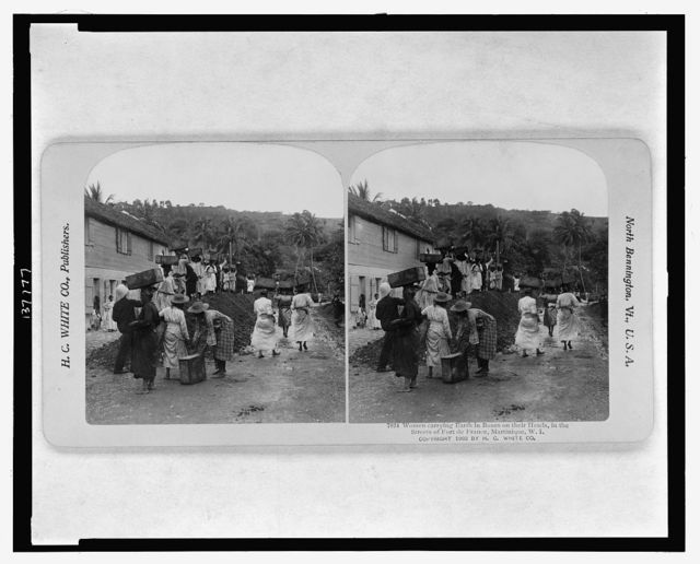 Women carrying earth in boxes on their heads, in the streets of Fort de France, Martinique, W.I.
