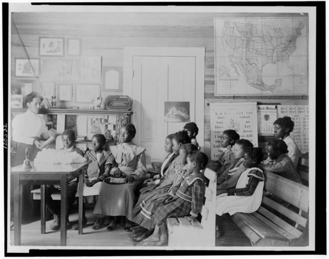 [Young students in a classroom at the Tuskegee Normal and Industrial Institute]