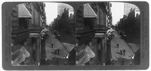 """23rd St., East from Sixth Ave., showing the twenty story """"Flatiron"""" Building, New York"""
