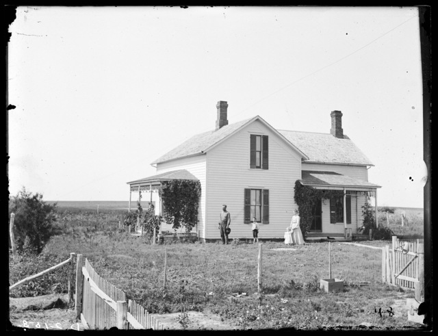 C.B. Marsh family in front of home, Amherst, Buffalo County, Nebraska.