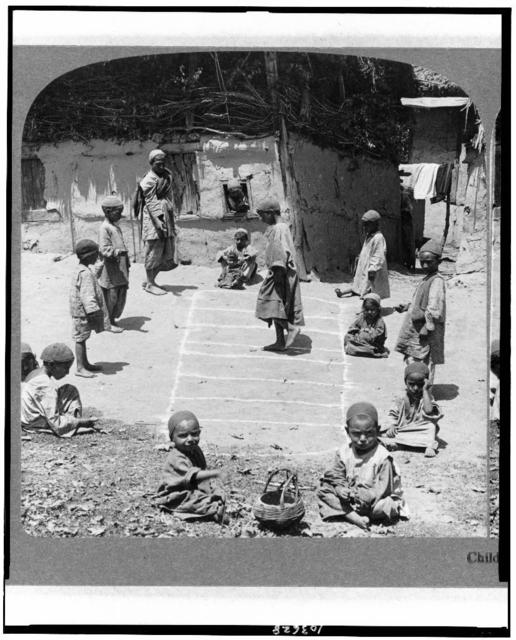 Children are children the wide world round--little folks playing Hop Scotch in Cashmere, India